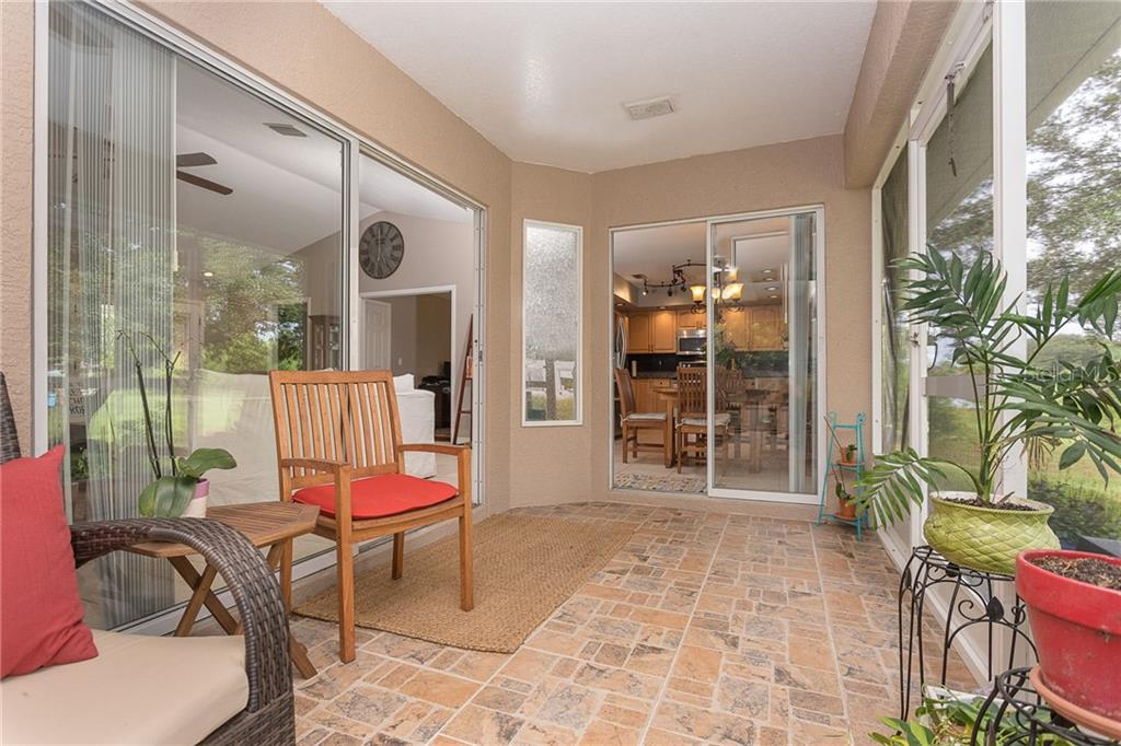 The large sliding doors open to expand your living space onto the lanai - Single Family Home for sale at 185 Apollo Dr, Rotonda West, FL 33947 - MLS Number is D6113690