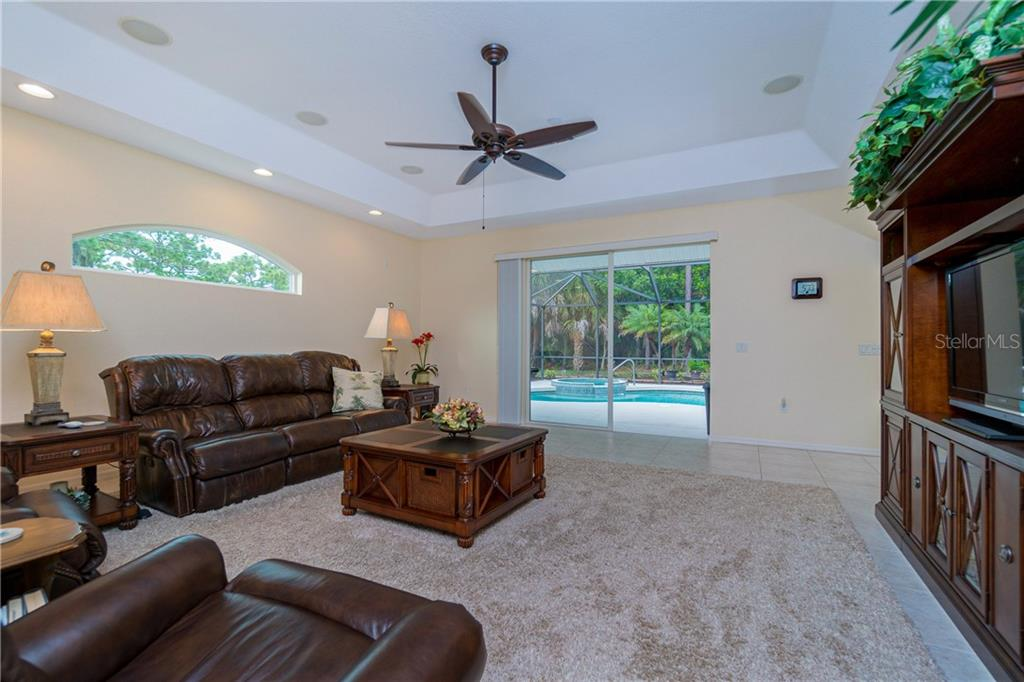 Family room has sliding glass doors to the lanai. - Single Family Home for sale at 439 Boundary Blvd, Rotonda West, FL 33947 - MLS Number is D6114162