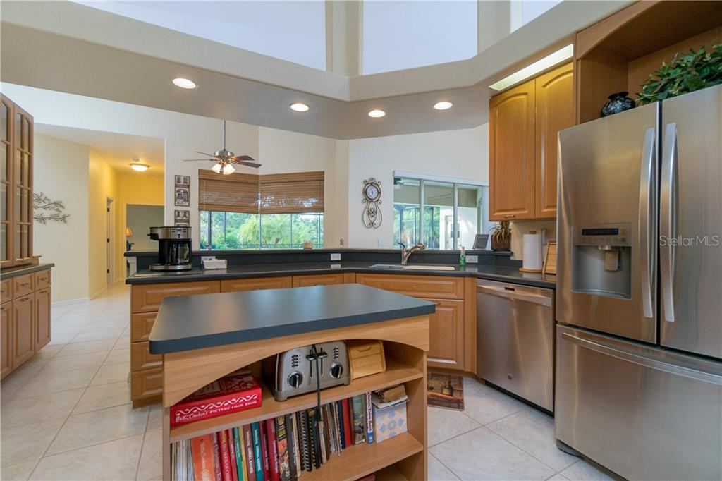Kitchen is open to the breakfast nook and living room. - Single Family Home for sale at 439 Boundary Blvd, Rotonda West, FL 33947 - MLS Number is D6114162