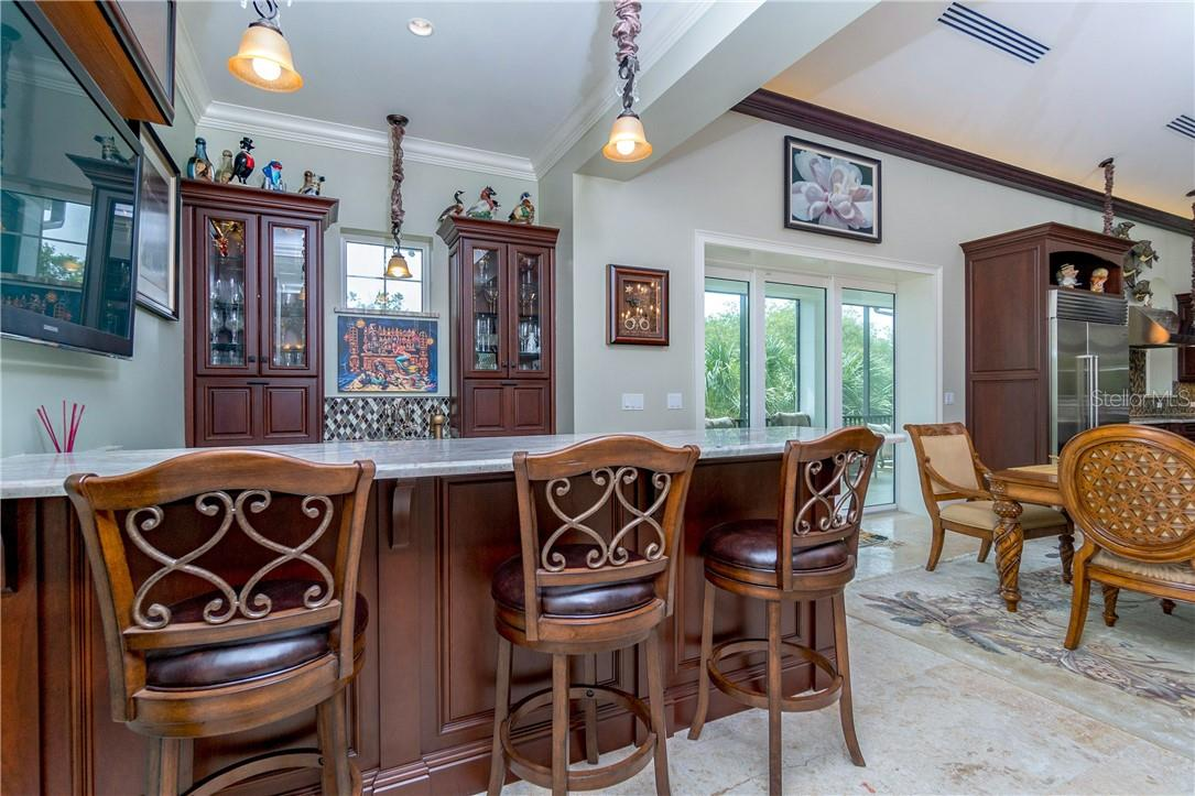 Half-bathroom just off the wet bar entertaining area - Single Family Home for sale at 10161 Eagle Preserve Dr, Englewood, FL 34224 - MLS Number is D6114216
