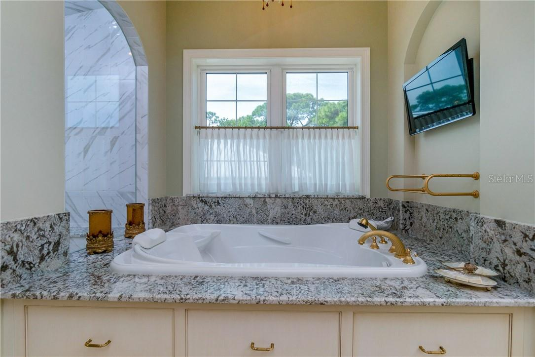 One of two sink & vanity areas with full vanity to ceiling mirror - Single Family Home for sale at 10161 Eagle Preserve Dr, Englewood, FL 34224 - MLS Number is D6114216