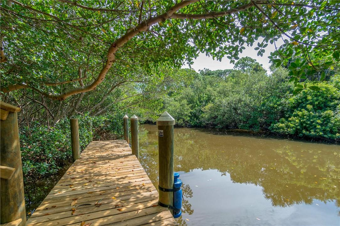 Rear lanai entertainment space with gas grill and fire pit - Single Family Home for sale at 10161 Eagle Preserve Dr, Englewood, FL 34224 - MLS Number is D6114216