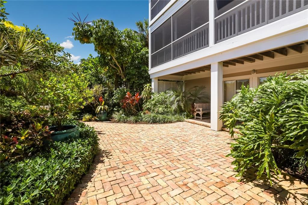 Ground level patio with Chicago Brick - Single Family Home for sale at 561 Buttonwood Bay Dr, Boca Grande, FL 33921 - MLS Number is D6114322