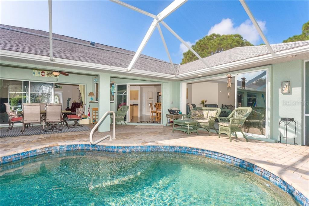 Large lanai allows for plenty of entertaining options - Single Family Home for sale at 1720 Larson St, Englewood, FL 34223 - MLS Number is D6114414