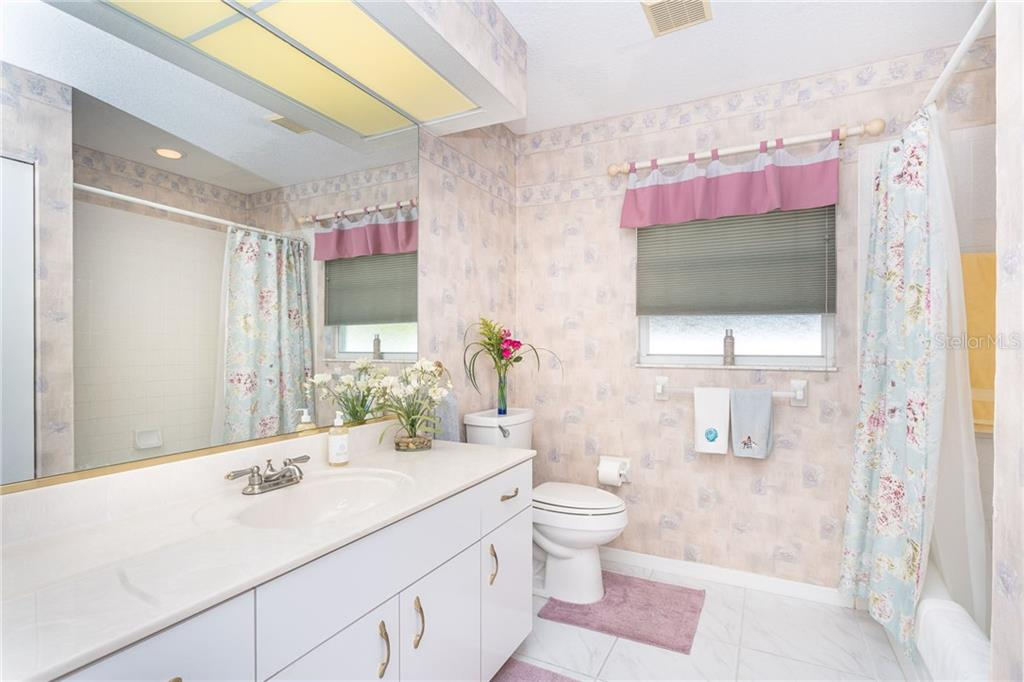bathroom 2 - large, with a tub and shower - Single Family Home for sale at 1720 Larson St, Englewood, FL 34223 - MLS Number is D6114414