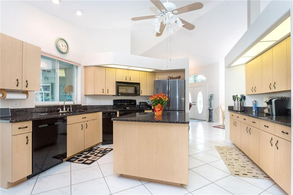 Very well designed kitchen offers all of the modern conveniences in a very functional space and easy assess to the lanai - Single Family Home for sale at 1720 Larson St, Englewood, FL 34223 - MLS Number is D6114414