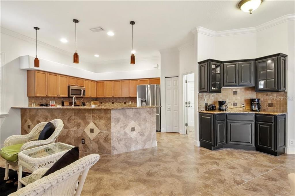 COFFEE BAR - Single Family Home for sale at 1944 Coconut Palm Cir, North Port, FL 34288 - MLS Number is D6114523