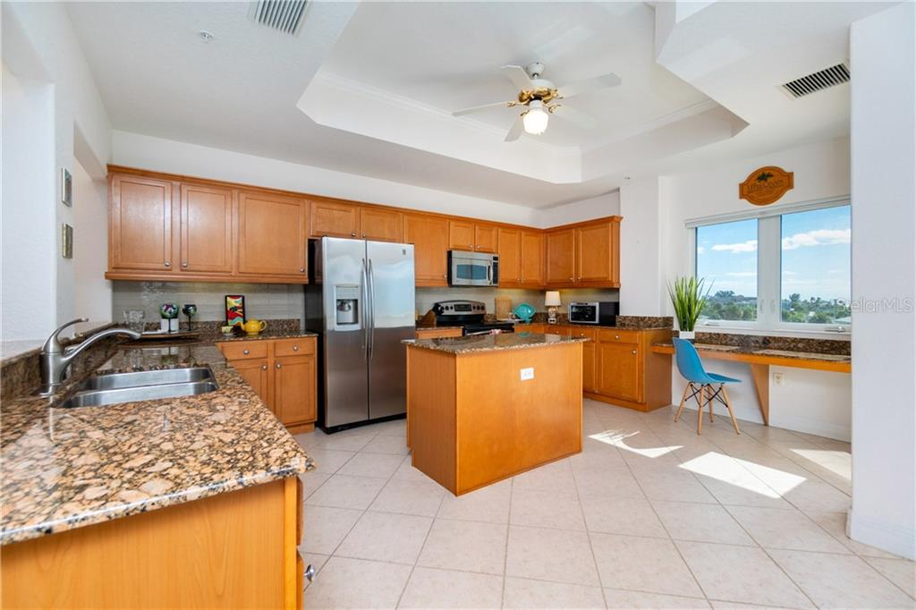 Spacious Kitchen with Center Island - Condo for sale at 2225 N Beach Rd #401, Englewood, FL 34223 - MLS Number is D6114646