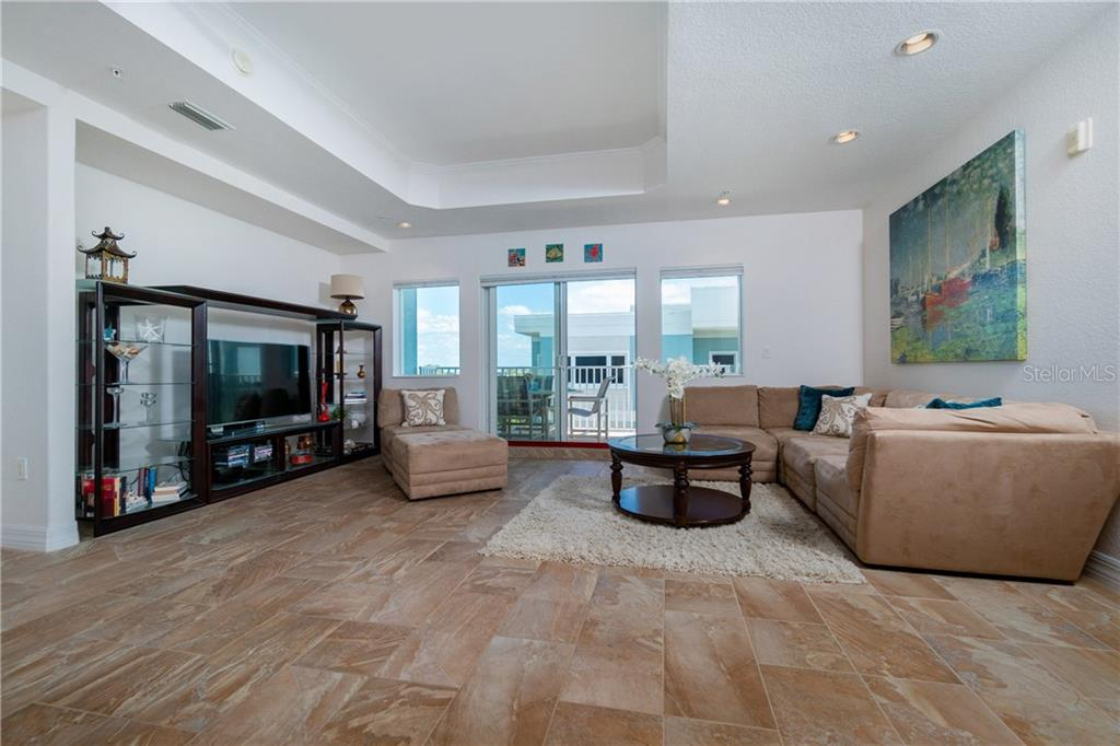 Spacious Living Room Looking Out - Condo for sale at 2225 N Beach Rd #401, Englewood, FL 34223 - MLS Number is D6114646