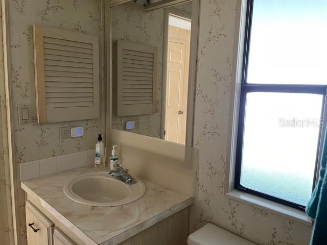 Guest bathroom - Manufactured Home for sale at 6384 Kilepa Ct, North Port, FL 34287 - MLS Number is D6114877
