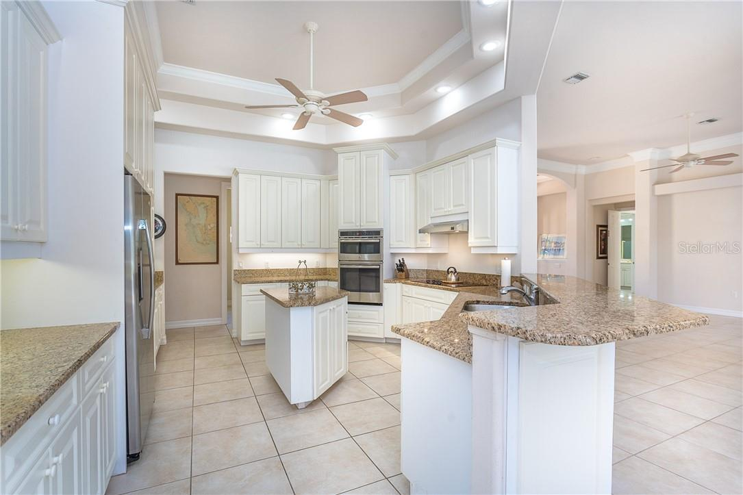 Florida Style Kitchen awaiting any gourmet chef - Single Family Home for sale at 18 Saint Croix Way, Englewood, FL 34223 - MLS Number is D6114880