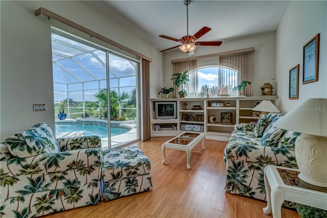 What Florida Manse would be complete without a poolside study / den/ family room. - Single Family Home for sale at 12307 S Access Rd, Port Charlotte, FL 33981 - MLS Number is D6117140