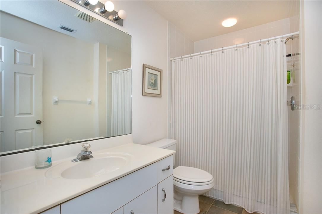 Bathroom 1 - Condo for sale at 6610 Gasparilla Pines Blvd #229, Englewood, FL 34224 - MLS Number is D6117434
