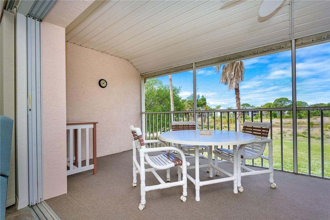 Covered and screened patio overlooking the preserve - Condo for sale at 6610 Gasparilla Pines Blvd #229, Englewood, FL 34224 - MLS Number is D6117434