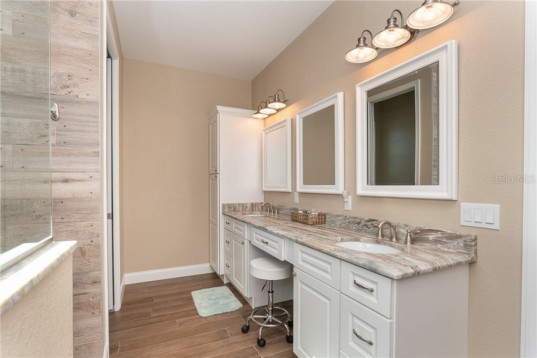 Bathroom 1 with dual sinks and large walk-in shower - Single Family Home for sale at 145 Leland St Se, Port Charlotte, FL 33952 - MLS Number is D6117438