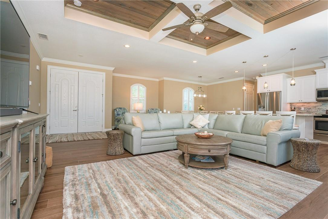 Living room with magnificent cypress inlaid ceilings - Single Family Home for sale at 145 Leland St Se, Port Charlotte, FL 33952 - MLS Number is D6117438
