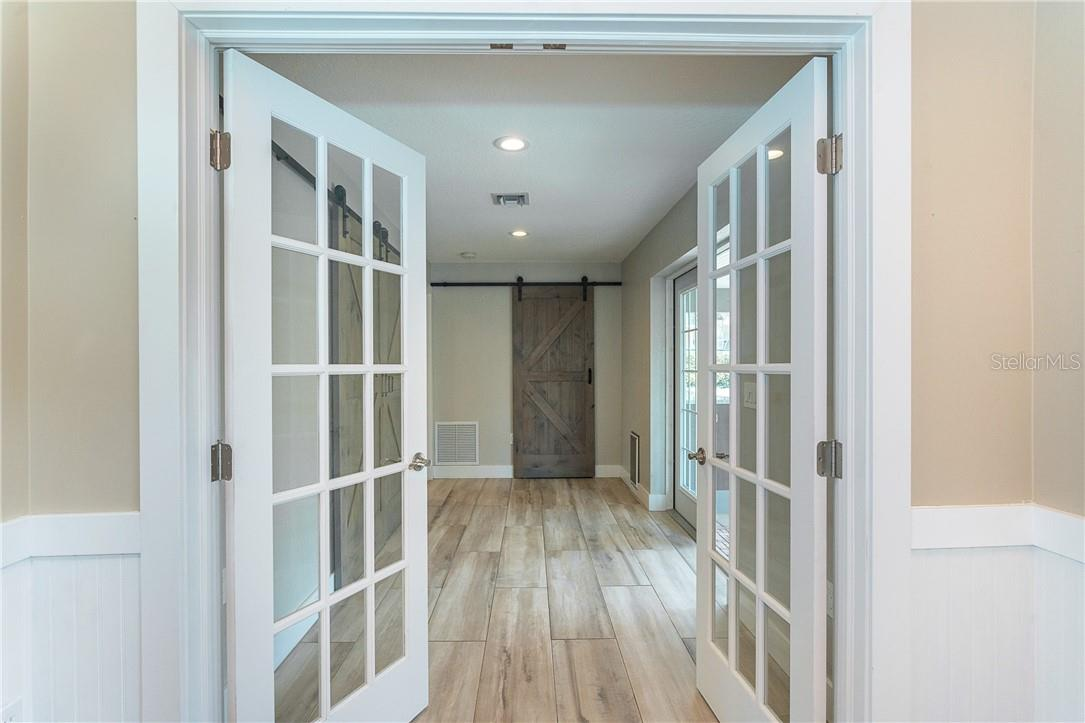 New Addition - French Doors leading from Great Room/Dining Area to either a 3rd bedroom for your guests or an office.  Gorgeous flooring !! - Single Family Home for sale at 1661 New Point Comfort Rd, Englewood, FL 34223 - MLS Number is D6117712