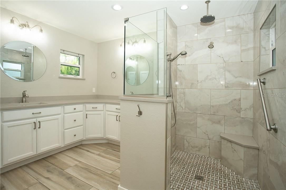 Master Bath with rain shower so you will never stand without water in every direction - Single Family Home for sale at 1661 New Point Comfort Rd, Englewood, FL 34223 - MLS Number is D6117712
