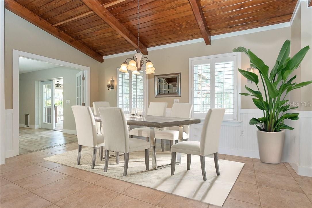Dining Room overlooking backyard and open to Kitchen and Great Room - Single Family Home for sale at 1661 New Point Comfort Rd, Englewood, FL 34223 - MLS Number is D6117712