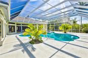 the pool area features 6 sliders that open into the pool area. The pool has been completely remodeled. - Single Family Home for sale at 3121 Rivershore Ln, Port Charlotte, FL 33953 - MLS Number is D5917816