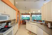 Kitchen and Breakfast Area - Single Family Home for sale at 5660 Riviera Ct, North Port, FL 34287 - MLS Number is D5919107