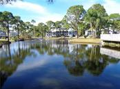 One of two ponds filled and surrounded with wildlife - Condo for sale at 6800 Placida Rd #253, Englewood, FL 34224 - MLS Number is D5919792