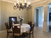 Dining room can comfortably seat 5 as it is configured, but it is open enough to allow for much larger pieces. - Condo for sale at 8541 Amberjack Cir #402, Englewood, FL 34224 - MLS Number is D5923680