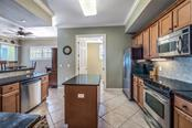 Solid wood cabinets, granite and stainless steel...plenty of prep space - Condo for sale at 8541 Amberjack Cir #402, Englewood, FL 34224 - MLS Number is D5923680