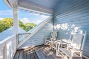 Deck off of upper level master bedroom - Single Family Home for sale at 186 Carrick Bend Ln, Boca Grande, FL 33921 - MLS Number is D5923688