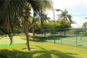 Putting green to sharpen your skills. - Condo for sale at 8409 Placida Rd #403, Placida, FL 33946 - MLS Number is D6102047