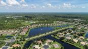 Stillwater is built around this retention lake offering another serene and beautiful landscape to enjoy while on your way to the local YMCA or to the clubhouse and pool. - Villa for sale at 29704 Niagara Ct, Englewood, FL 34223 - MLS Number is D6102386