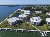 Rear aerial view from Marina - Condo for sale at 11000 Placida Rd #2103, Placida, FL 33946 - MLS Number is D6102674