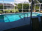 Inground Pool has AutoVac System - Single Family Home for sale at 7 Old Trail Rd, Englewood, FL 34223 - MLS Number is D6102912
