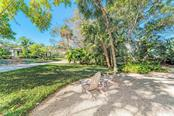 Its always cooler in the shade. - Single Family Home for sale at 7400 Manasota Key Rd, Englewood, FL 34223 - MLS Number is D6104362