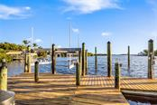 Deep water lighted dock has fresh water, a 16,000 lb lift + smaller lift - Single Family Home for sale at 1600 E Railroad Ave, Boca Grande, FL 33921 - MLS Number is D6108744