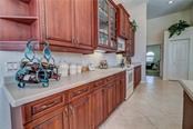Abundant counter space and cabinetry with under cabinet work lighting and over cabinet mood lighting.. - Single Family Home for sale at 12307 S Access Rd, Port Charlotte, FL 33981 - MLS Number is D6117140
