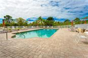 Large pool and lounging deck - Condo for sale at 6610 Gasparilla Pines Blvd #229, Englewood, FL 34224 - MLS Number is D6117434