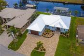 Beautifully landscaped property, just minutes to fine dining and shops and steps to your boat - Single Family Home for sale at 145 Leland St Se, Port Charlotte, FL 33952 - MLS Number is D6117438