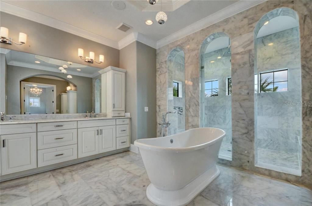 Master bath, soaking tub and jetted shower - Single Family Home for sale at 1400 Harbor Sound Dr, Longboat Key, FL 34228 - MLS Number is T2932520
