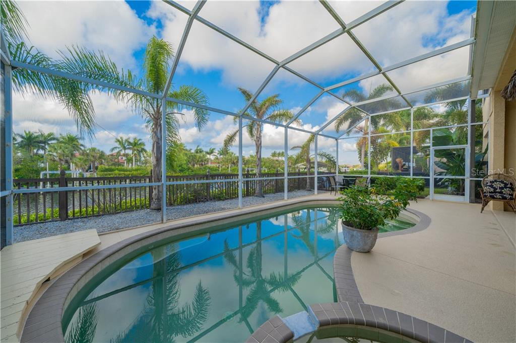 Screened in pool with spa overlooking the canal and Hawk Island - Single Family Home for sale at 3811 5th Ave Ne, Bradenton, FL 34208 - MLS Number is T3164424
