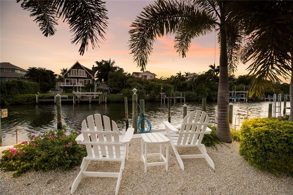 A cozy spot to watch boats arrive at the new Trex dock with power and water - Single Family Home for sale at 511 Loquat Dr, Anna Maria, FL 34216 - MLS Number is T3196169