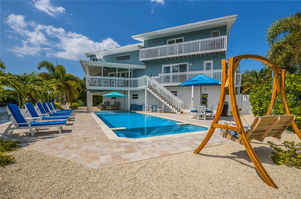 Decks, patios and balconies afford all of your guests amazing views - Single Family Home for sale at 511 Loquat Dr, Anna Maria, FL 34216 - MLS Number is T3196169