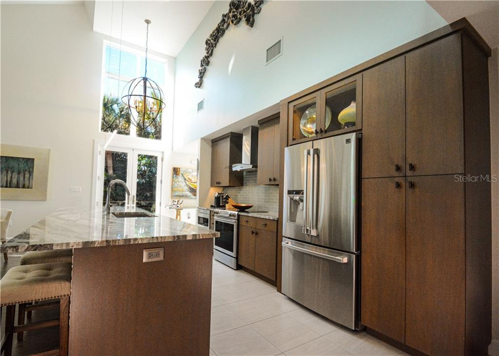Updated open plan kitchen - Single Family Home for sale at 140 N Casey Key Rd, Osprey, FL 34229 - MLS Number is T3228618