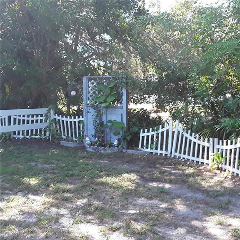 LEFT SIDE YARD - Single Family Home for sale at 5171 Albion Rd, Venice, FL 34293 - MLS Number is V4914784