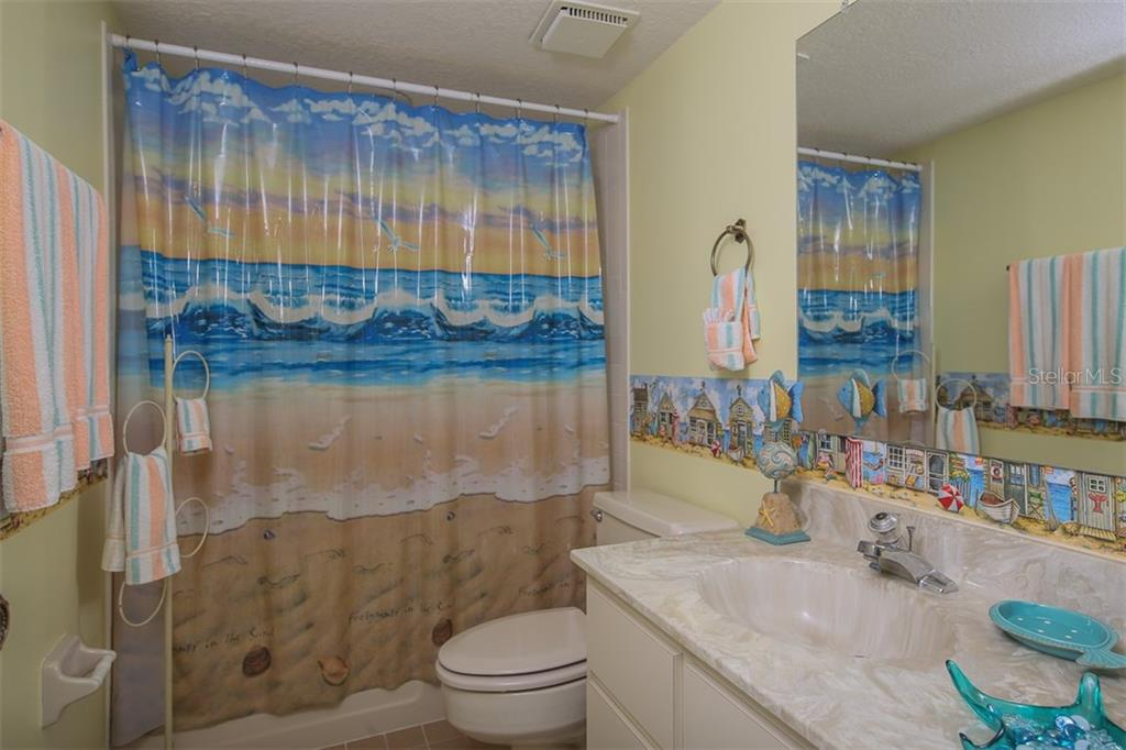 Guest bathroom with shower/tub combination - Condo for sale at 1765 Jamaica Way #302, Punta Gorda, FL 33950 - MLS Number is C7234643