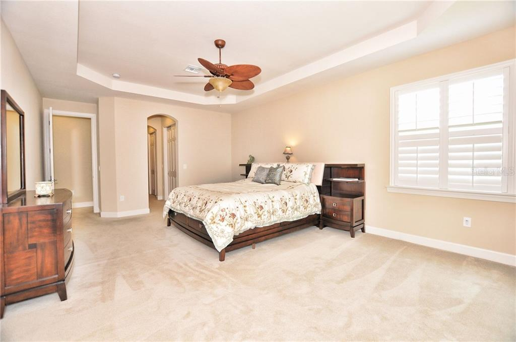 Luxurious Master Suite with ample room for sitting area, desk, and/or lounge area. - Single Family Home for sale at 2839 Mill Creek Rd, Port Charlotte, FL 33953 - MLS Number is C7238545