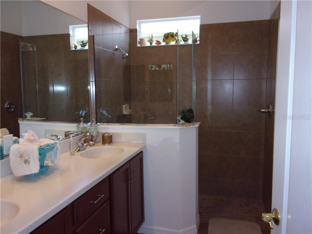 Walk-In Shower with Double Sinks and Separate Water Closet - Villa for sale at 1912 Knights Bridge Trl, Port Charlotte, FL 33980 - MLS Number is C7239595