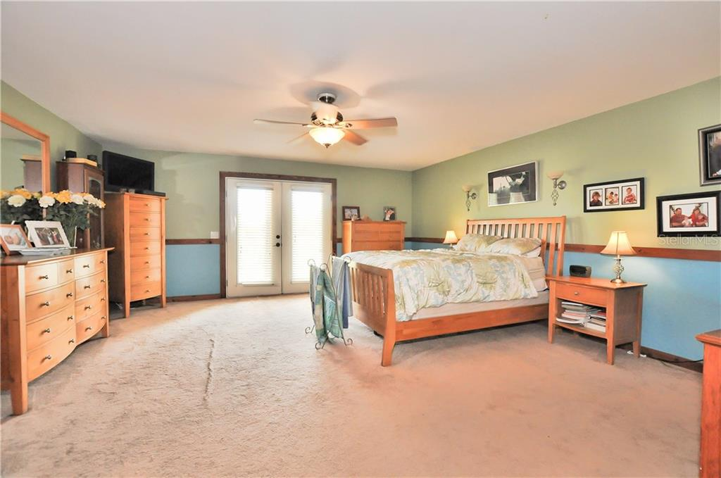 Master Bedroom with French Doors to the front porch - Single Family Home for sale at 30720 Washington Loop Rd, Punta Gorda, FL 33982 - MLS Number is C7239690
