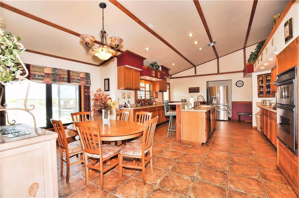 Country kitchen perfect for a feast! - Single Family Home for sale at 30720 Washington Loop Rd, Punta Gorda, FL 33982 - MLS Number is C7239690