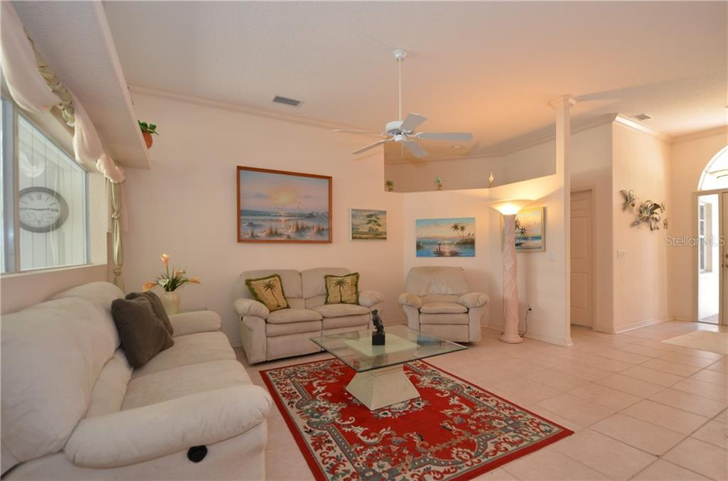 Family Room with Slider to the Lanai - Single Family Home for sale at 25458 Aysen Dr, Punta Gorda, FL 33983 - MLS Number is C7239700